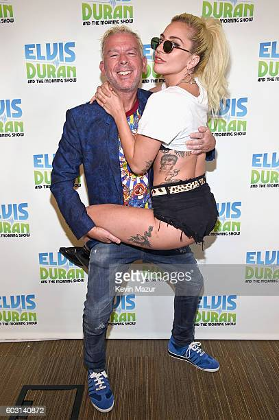 Elvis Duran and Lady Gaga pose during her visit to The Elvis Duran Z100 Morning Show at Z100 Studio on September 12 2016 in New York City