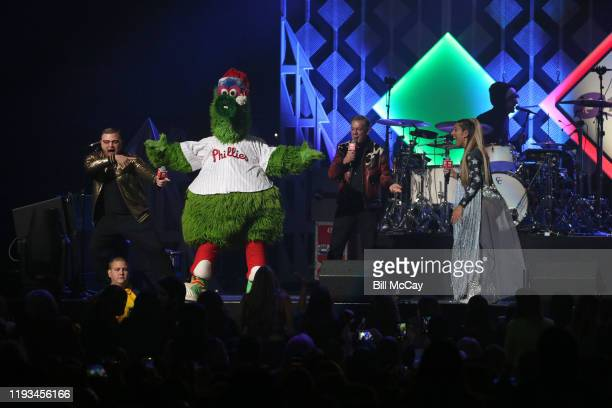 Elvis Duran and Phillie Phanatic attend Q102's Jingle Ball 2019 Presented by Capital One at Wells Fargo Center on December 11, 2019 in Philadelphia,...