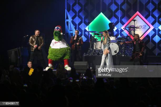 Elvis Duran and Phillie Phanatic attend Q102's Jingle Ball 2019 Presented by Capital One at Wells Fargo Center on December 11 2019 in Philadelphia...