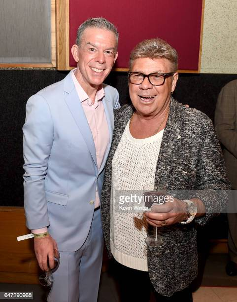 Elvis Duran and singer Uncle Johnny pose at a reception celebrating radio personality Elvis Duran's star on the Hollywood Walk of Fame at Capitol...