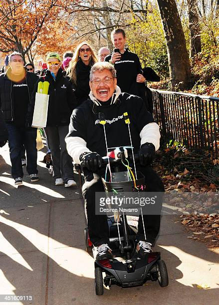 Elvis Duran and Z100's Uncle Johnny with Eric Trump and Lara Yunaska walking in the back take part in the 'Elvis Trumps Cancer Walk' for St Jude...