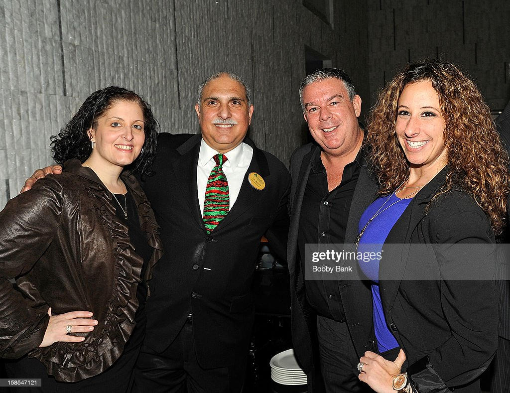 Elvis Duran (2nd from R) attends 2012 Staten Island Zoo Christmas Party Hosted By Elvis Duran at Staten Island Hilton on December 18, 2012 in New York City.