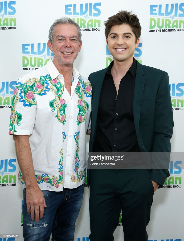 Elvis Duran poses as singer Cole Redding visits 'The Elvis Duran Z100 Morning Show' at Z100 Studio on June 14, 2018 in New York City.