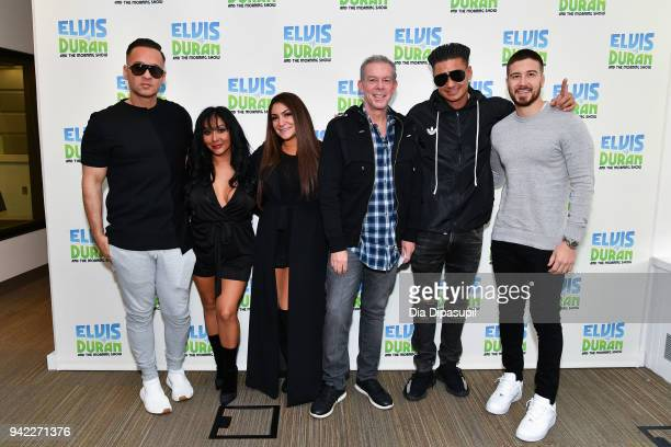 Elvis Duran poses with Jersey Shore Family Vacation cast members Mike The Situation Sorrentino Nicole Snooki Polizzi Deena Nicole Cortese Paul Pauly...