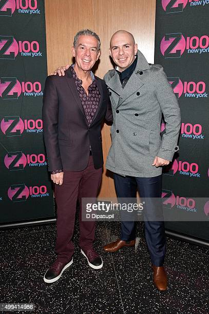 Elvis Duran poses with Pitbull during his visit to The Elvis Duran Z100 Morning Show at One World Observatory on December 1 2015 in New York City