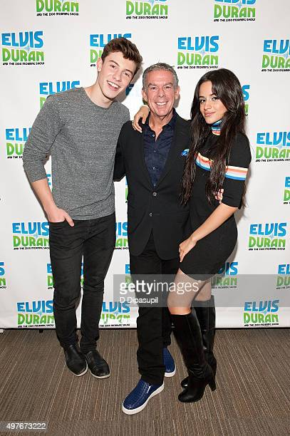 Elvis Duran poses with Shawn Mendes and Camila Cabello during their visit to The Elvis Duran Z100 Morning Show at Z100 Studio on October 23 2015 in...