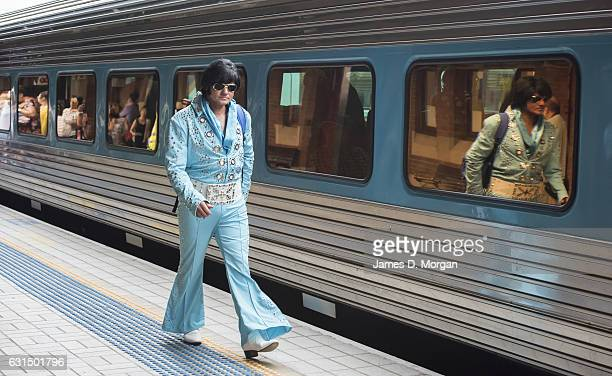 Elvis fans and impersonators wait to board the 'Elvis Express' a dedicated train service as it prepares to depart Central Station for the annual...