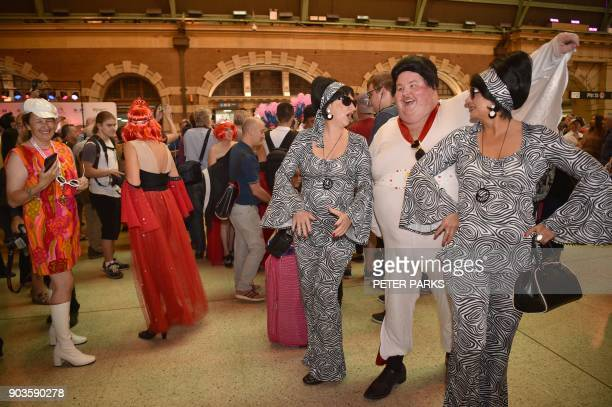 Elvis fans arrive at Central station to board a train to The Parkes Elvis Festival in Sydney on January 11 2018 The Parkes Elvis Festival is an...