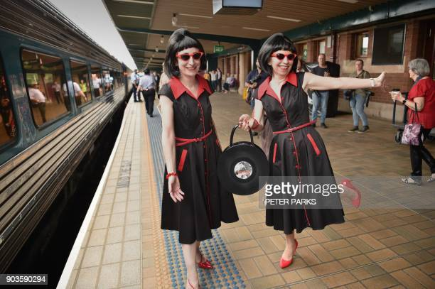 Elvis fans pose at Central station before boarding a train to The Parkes Elvis Festival in Sydney on January 11 2018 The Parkes Elvis Festival is an...