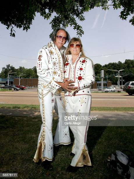 Elvis fans Tom Elliott and wife Robin Elliott from Illinois pose for a photo at Graceland Crossing during Elvis Week 2005 August 12 2005 in Memphis...