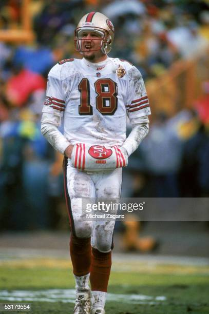Elvis Grbac of the San Francisco 49ers stands on the field against the Green Bay Packers during the 1996 NFC Divisional Playoff game at Lambeau Field...