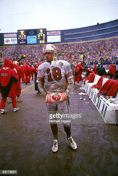 Elvis Grbac of the San Francisco 49ers stands on the sideline against the Green Bay Packers during the 1996 NFC Divisional Playoff game at Lambeau...