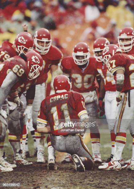 Elvis Grbac Quarterback for the Kansas City Chiefs calls the play to his offensive line in the huddle during the American Football Conference West...