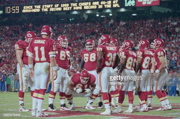 Elvis Grbac Quarterback for the Kansas City Chiefs stands in the huddle with his offensive unit during the American Football Conference West game...