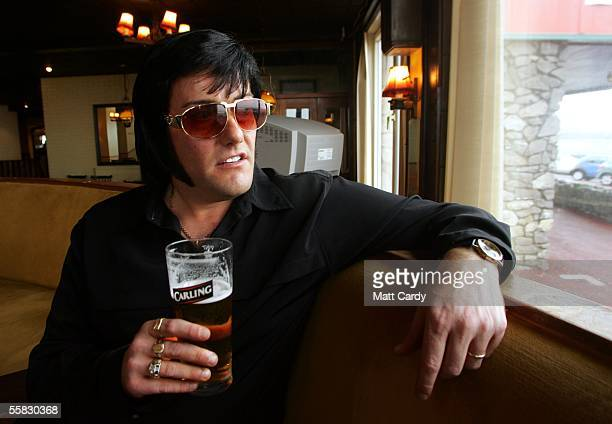 Elvis impersonator Marc George stops to have a pint in the Smugglers Bar on the seafront ahead of the events at the 2005 Porthcawl Elvis Festival...