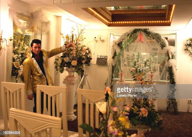 Elvis impersonator showing interior of wedding chapel.