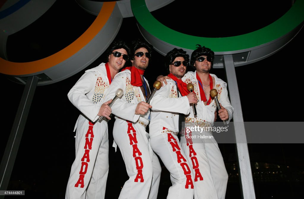 Elvis impersonators from Canada pose under the rings during the Closing Ceremony of the Sochi 2014 Winter Olympics at Fisht Olympic Stadium on February 23, 2014 in Sochi, Russia.