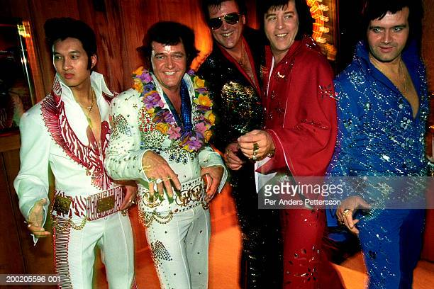 Elvis impersonators pose for pictures