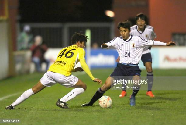 Elvis Lima Sousa of F91 and Takefusa Kubo of Japan fight for the ball during a friendly soccer match between F91 Diddeleng and the Japan U20 team at...