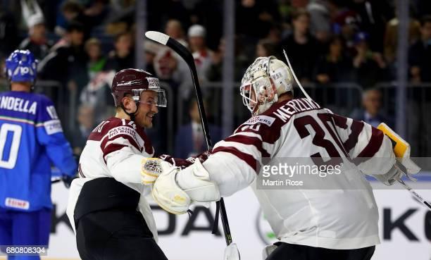 Elvis Merzlikins goaltender of Latvia celebrate with team mate Rihards Bukarts after the 2017 IIHF Ice Hockey World Championship game between Italy...