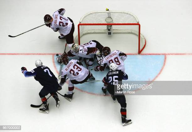 Elvis Merzlikins goaltender of Latvia maks a save against United States during the 2018 IIHF Ice Hockey World Championship Group B game between...
