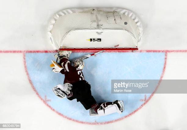 Elvis Merzlikins goaltender of Latvia receives the 2nd goal during the 2017 IIHF Ice Hockey World Championship game between Sweden and Latvia at...