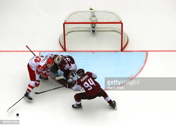 Elvis Merzlikins goaltender of Latvia tends net against Patrick Russell of Denmark during the 2018 IIHF Ice Hockey World Championship Group B game...