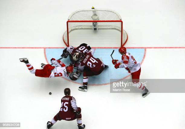 Elvis Merzlikins goaltender of Latvia tends net against Philip Larsen of Denmark during the 2018 IIHF Ice Hockey World Championship Group B game...