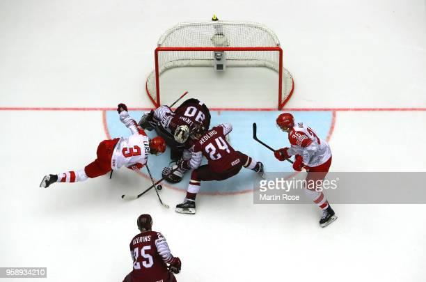Elvis Merzlikins goaltender of Latvia tends net against Philip Larsen of Denmark during the 2018 IIHF Ice Hockey World Championship Group B game...