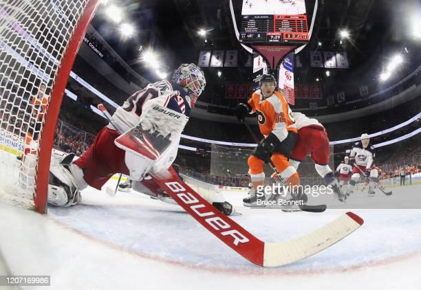 Elvis Merzlikins of the Columbus Blue Jackets blocks the net against Connor Bunnaman of the Philadelphia Flyers at the Wells Fargo Center on February...