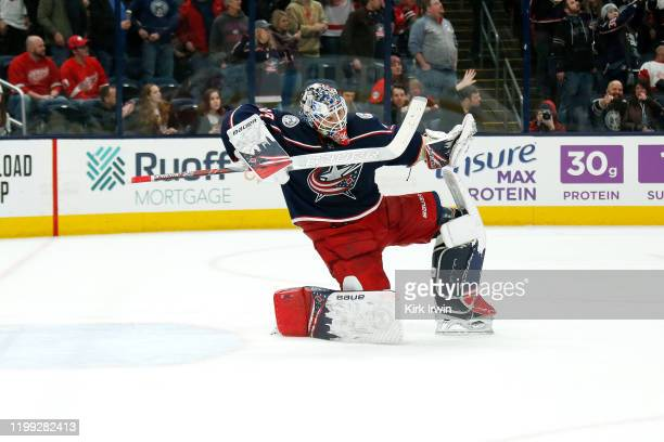 Elvis Merzlikins of the Columbus Blue Jackets celebrates after shutting out the Detroit Red Wings on February 7 2020 at Nationwide Arena in Columbus...