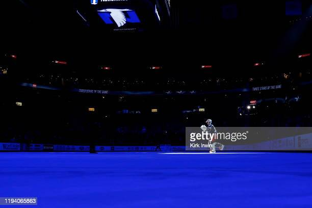 Elvis Merzlikins of the Columbus Blue Jackets is spotlit while being recognized as the second star against the Carolina Hurricanes on January 16 2020...