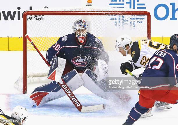 Elvis Merzlikins of the Columbus Blue Jackets makes the third period save against the Boston Bruins in an exhibition game prior to the 2020 NHL...