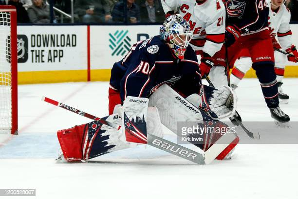 Elvis Merzlikins of the Columbus Blue Jackets prepares to make a save during the game against the Carolina Hurricanes on January 16 2020 at...