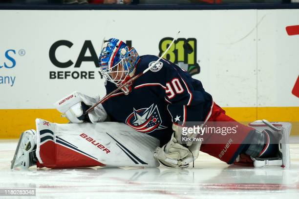 Elvis Merzlikins of the Columbus Blue Jackets warms up prior to the start of the game against the Buffalo Sabres on October 7 2019 at Nationwide...