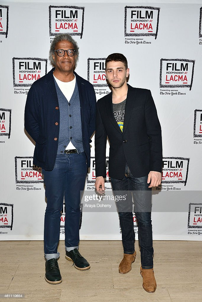 Elvis Mitchell and Xavier Dolan attend the Film Independent at LACMA screening and Q&A of 'Mommy' at Bing Theatre At LACMA on January 6, 2015 in Los Angeles, California.