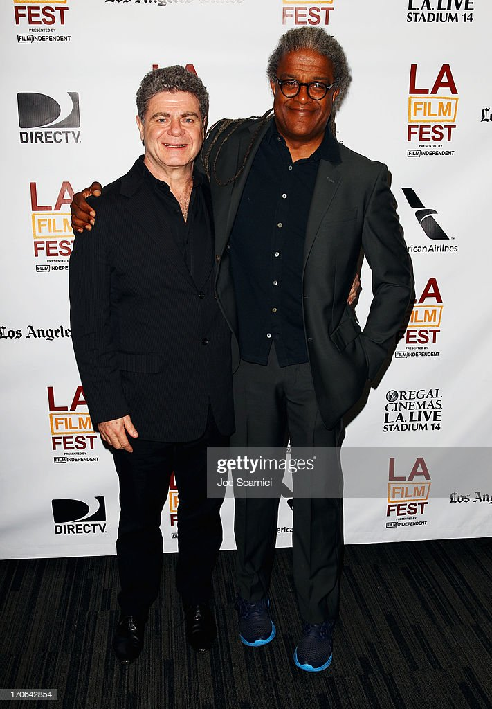 Elvis Mitchell, Curator, Film Independent at LACMA and musician Gustavo Santaolalla arrive at the Master Class: Gustavo Santoalalla - Music Scores That Move Us during the 2013 Los Angeles Film Festival at The GRAMMY Museum on June 15, 2013 in Los Angeles, California.