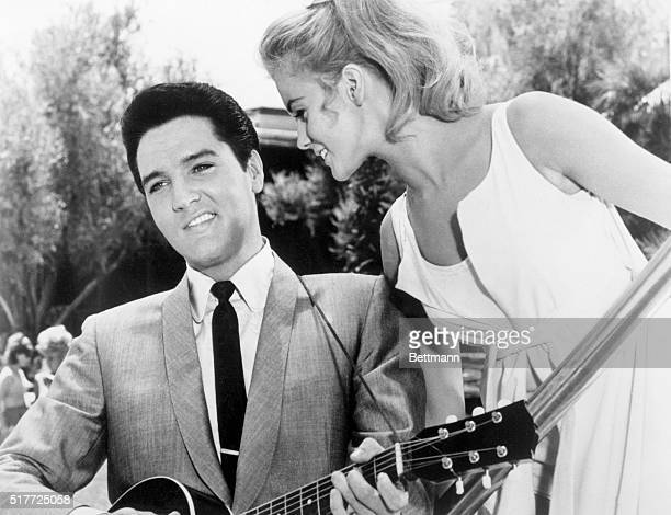 Elvis Presley and AnnMargret appear together in the 1964 film Viva Las Vegas Presley plays the guitar