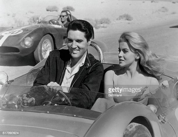 Elvis Presley and AnnMargret in scene from the movie 'Viva Las Vegas' They are riding a stock car BPA2