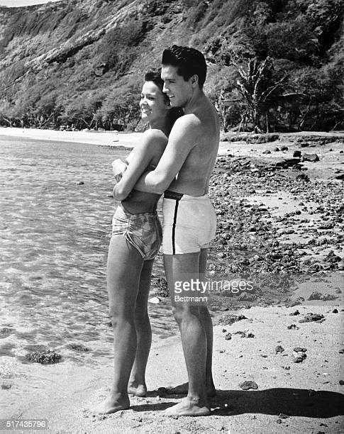 Elvis Presley and Joan Blackman playing the respective roles of Chad Gates and Maile Duval in a romantic beach scene from the 1961 musical comedy...