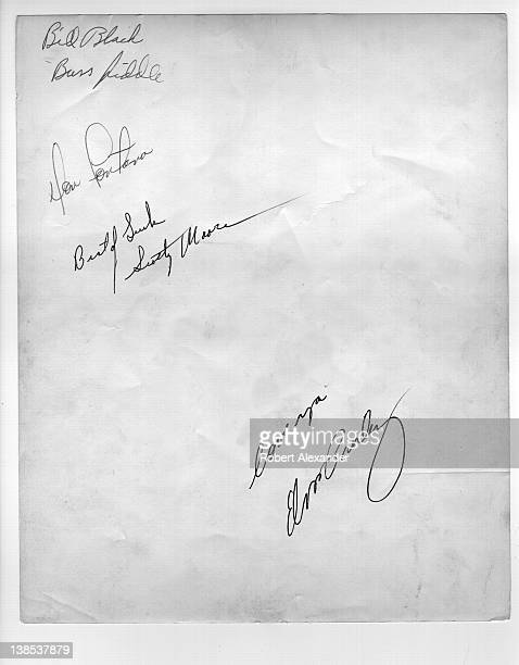 Elvis Presley and members of his first touring band Bill Black DJ Fontana and Scotty Moore autographed the back of a publicity photograph in 1955...