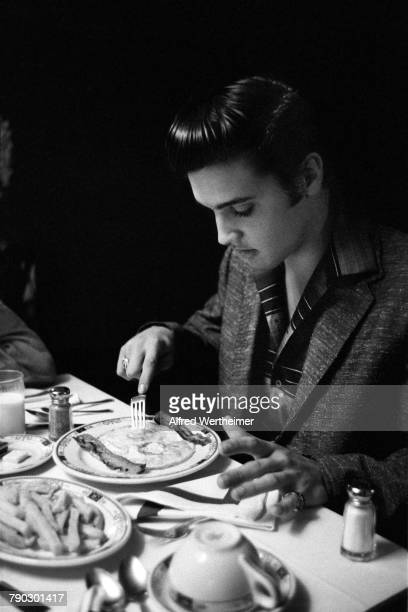 Elvis Presley eating in the dining room at the Jefferson Hotel restaurant in Richmond Virginia 30th June 1956 Elvis was to perform two shows later at...