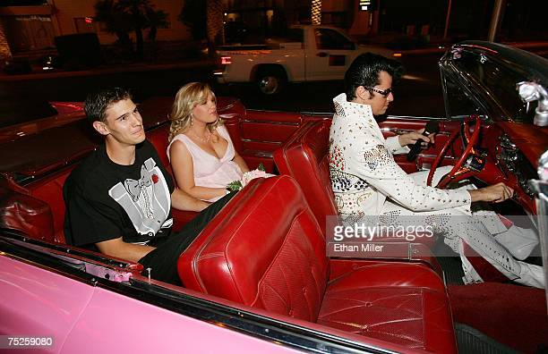 Elvis Presley impersonator Brian Mills gets ready to drive Jack Burch and Hannah Kleinhaus of Wyoming into the chapel in a pink Cadillac for their...