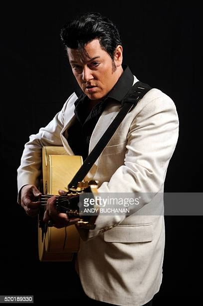 Elvis Presley impersonator Bruce Stewart from Canada poses backstage before performing at the first Scottish Elvis Festival on April 8 2016 in...