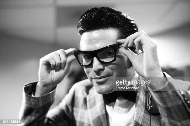 Elvis Presley impersonator Dean Z dressed as Buddy Holly attends the Las Vegas Elvis Festival at Sam's Town Hotel Gambling Hall on July 14 2018 in...