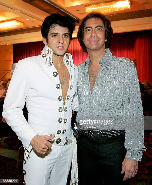 Elvis Presley impersonator Donny Edwards of Nevada and Neil Diamond impersonator Rob Garrett of Nevada pose opening night of the International Guild...