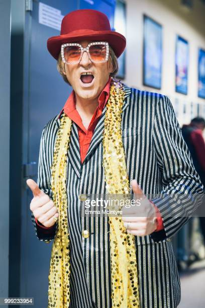 Elvis Presley impersonator Dwight Icenhower dressed as Elton John attends the Las Vegas Elvis Festival at Sam's Town Hotel Gambling Hall on July 14...