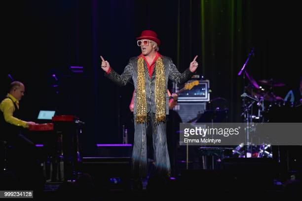 Elvis Presley impersonator Dwight Icenhower performs onstage as Elton John at the Las Vegas Elvis Festival at Sam's Town Hotel Gambling Hall on July...