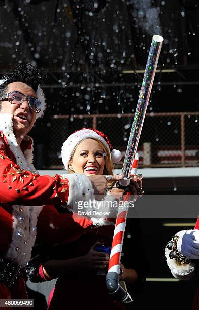 Elvis Presley Impersonator Jesse Garon And Model Television Personality Holly Madison Ear At The 10th