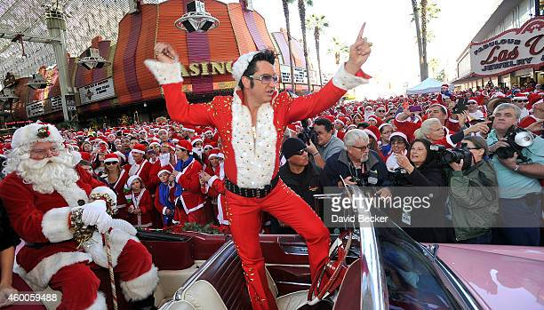 Elvis Presley Impersonator Jesse Garon Ears At The 10th Annual Las Vegas Great Santa Run Benefiting
